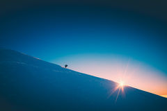 A climber climbs up a snowy slope. Instagram stylisation Royalty Free Stock Photography