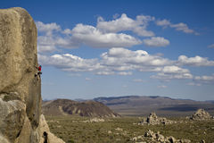Climber clinging to a cliff. Stock Photo