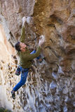 Climber clinging to a cliff. Royalty Free Stock Image