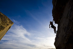 Climber clinging to a cliff. Royalty Free Stock Photo