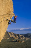 Climber clinging to a cliff. Stock Image
