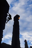 Climber clinging to a rock face. Royalty Free Stock Image