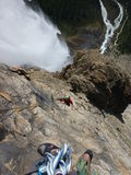Climbers ascending Takkakaw Falls Royalty Free Stock Image