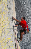 Climber dangling from the edge. Royalty Free Stock Image