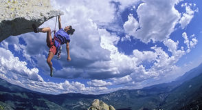 Climber dangling from the edge. Royalty Free Stock Images