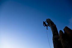 Climber dangling from a pinnacle. Royalty Free Stock Photo