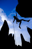 Climber dangling from a rope. Royalty Free Stock Image