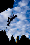 Climber dangling from a rope. Stock Photo