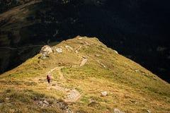 Climber descends the steep slope of mountain Stock Photos