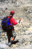 Active male climber on descent of Mt Kilimanjaro Stock Image