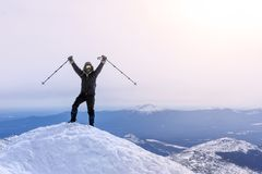 Climber rejoices, reaching the top of the mountain. Climber exults reaching the top of the mountain peak stock photo