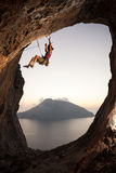 Climber falling of a cliff while lead climbing Stock Photos