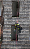 climber of firefighter climbing a wall of a house during the fir Royalty Free Stock Image