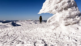 Climber on frozen mountain top Stock Photo