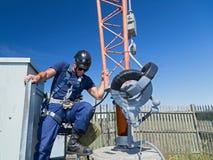 Climber gets ready to climb tower Stock Photo