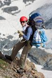 Climber girl going down on rope. In mountains Royalty Free Stock Photo