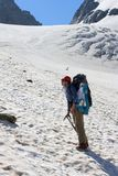 Climber girl hiking in mountains Stock Photo