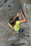 Climber girl on rock Royalty Free Stock Photos