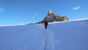 Climber on the glacier toward the Dent du Geant, in the Mt. Blan Royalty Free Stock Photos