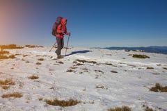 Climber goes through the snow. Stock Photos