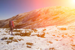 Climber goes through the snow. Royalty Free Stock Image