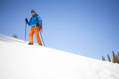 The climber goes on the snow slope. Stock Image
