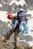 Climber going down. Tourist going down from rock Royalty Free Stock Photo