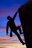 Climber going for the summit. Stock Photos