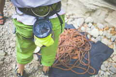 The climber is going to climb the rock. Royalty Free Stock Images