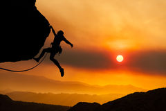 Climber grips the edge. Stock Photos