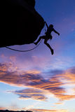Climber grips the edge. Stock Images