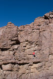 Climber halfway up cliff. A male climber half way up a 70 foot pitch in Chino Valley, Arizona Stock Photography