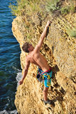 Climber hanging by a cliff Stock Image