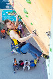 Climber hanging on climbing Wall at Competitions Royalty Free Stock Photo