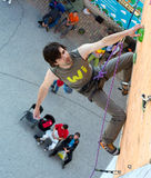 Climber hanging on climbing Wall at Competitions Royalty Free Stock Photography