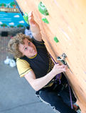 Climber hanging on climbing Wall at Competitions Royalty Free Stock Image