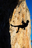 Climber hanging on rope Royalty Free Stock Images
