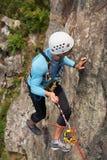 Climber overcomes rocky wall Stock Photos