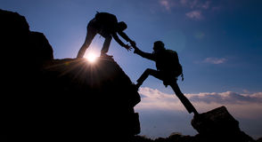 achieve together & Climber helping & success stock photography