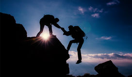 Climber helping & coaching education & bravo stock photography