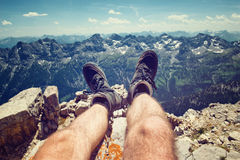 Climber in hiking boots on a rocky ledge Stock Photos