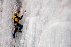 Climber on Ice. Climber on a frozen waterfall Royalty Free Stock Image