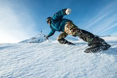Climber with an ice ax climb on the snowy mountain. Snowy Carpathian Mountains royalty free stock images