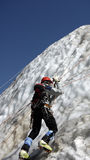 Climber ice-axe training. Mountain climber during ice training with ice-axe going up stock photography