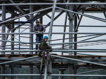 Climber. The installer or industrial mountaineering is a difficult activity focused on the execution of construction operations at height. This shot is made Stock Photos
