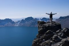 Climber and lake. An chinese men in peak of changbai mountain Royalty Free Stock Image
