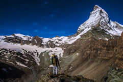 Climber looking at matterhorn mountain Royalty Free Stock Image