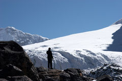 Climber looking at mountain slope, Himalaya Stock Images