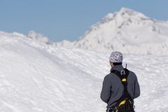 Climber is looking at the snow-covered mountain Royalty Free Stock Photo