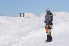 Climber is looking at the snow-covered mountain Royalty Free Stock Images